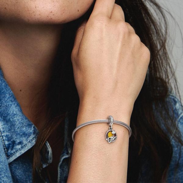 Woman wearing a chunky silver charm bracelet